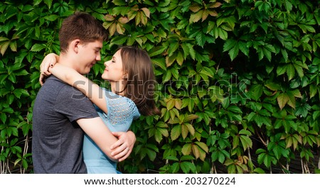 Stunning sensual outdoor portrait of young stylish fashion couple posing in summer - stock photo