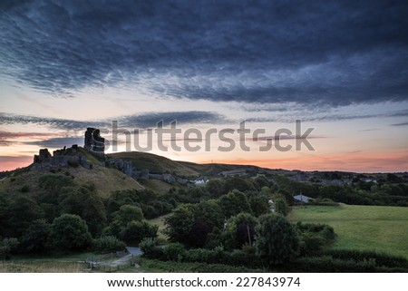 Stunning sunrise landscape over ruins of medieval castle - stock photo