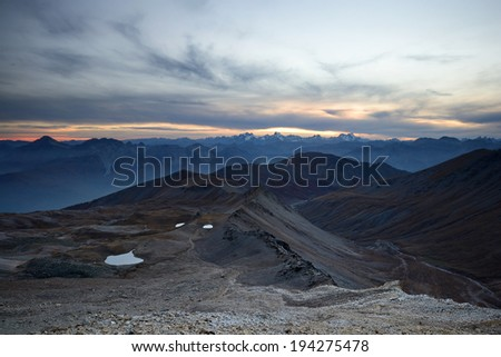 Stunning sunset high in the italian Alps on an extreme rocky landscape, near Bardonecchia, Torino Province, North-West Italy. - stock photo