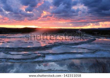 Stunning sunset landscape at a hot spring in Yellowstone National Park, Wyoming, USA. - stock photo