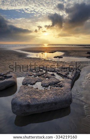 Stunning sunset landscape over Dunraven Bay in Wales - stock photo