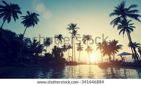 Stunning sunset on a tropical asian beach. - stock photo