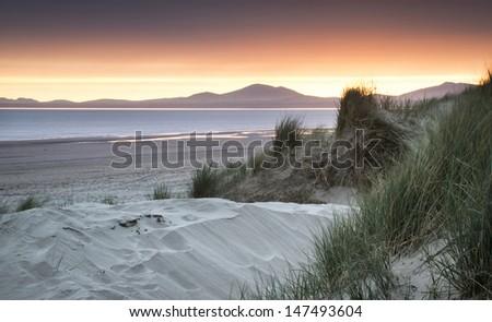 Stunning sunset over beach landscape seascape - stock photo
