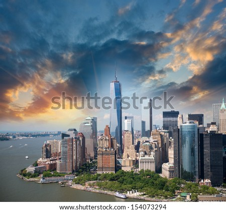 Stunning sunset over Lower Manhattan - Aerial view. - stock photo