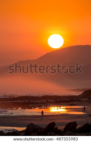 Stunning sunset with large round sun at the seaside in South Africa