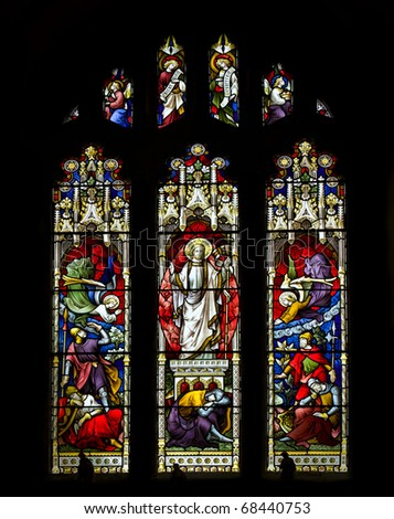 Stunning 15th Century stained glass window detail depicting resurrection of Jesus - stock photo