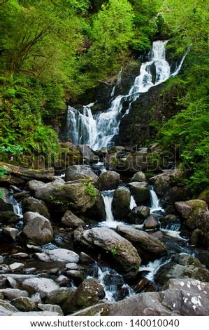 stunning Torc waterfall in the Killarney National Park, Ireland - stock photo