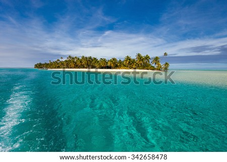 Stunning tropical Aitutaki One Foot island with palm trees, white sand, turquoise ocean water and blue sky at Cook Islands, South Pacific - stock photo