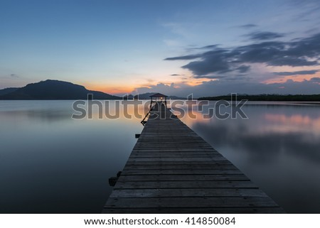Stunning Vibrant sunset at the jetty of Island Semporna, Sabah, Malaysia. Image contain grain, noise and soft focus due long exposure