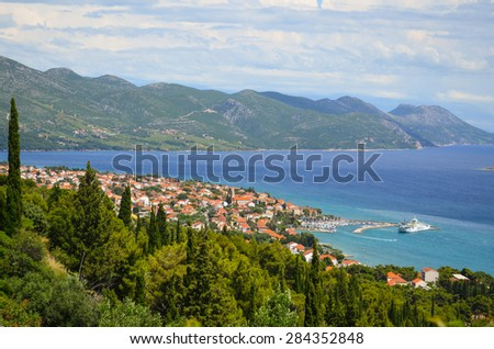 Stunning view from the hill on Mediterranean village with ferryboat harbor