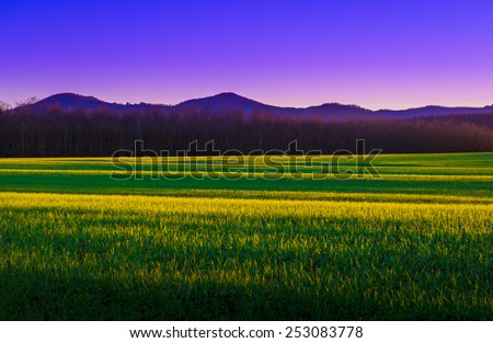 Stunning view of an Italian sunset landscape near Siena, Tuscany - stock photo