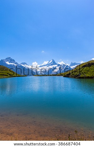 Stunning view of Bachalpsee and the snow coverd peaks with glacier of swiss alps, on Bernese Oberland, Switzerland. - stock photo