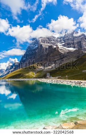 Stunning view of Eiger Northface and the glacier at the lake side of Fallbodensee on Bernese Oberland, Switzerland. - stock photo