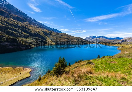 Stunning view of Engstlensee lake and the Alps on a sunny day on Bernese Oberland, Switzerland.