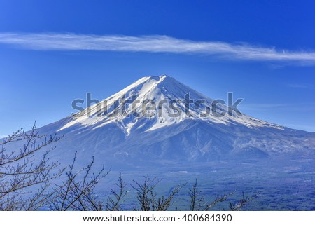 Stunning view of Fuji mountain taken from Kawaguchiko mt's scenic point, in clear blue sky with haze and smoke effect  at the bottom of mountain. - stock photo