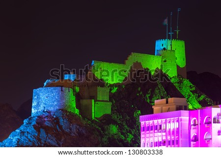Stunning View of Muttrah Fort in the night, Muscat, Oman - stock photo