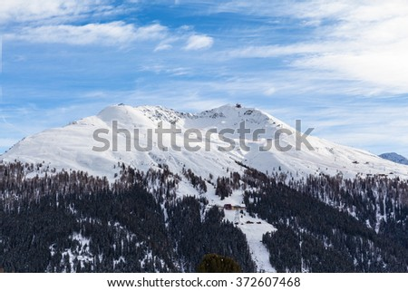 Stunning view of snow covered Jacobshorn above Davos town in Winter, Canton of Grisons, Switzerland - stock photo