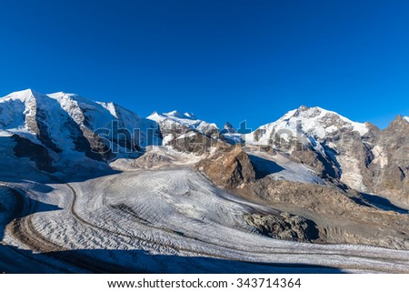 Stunning view of the Bernina massive including Piz Palu, Piz Bellavista, Piz Bernina and Morteratsch glacier at the mountain house Diavolezza in Engadin area of Switzerland. - stock photo