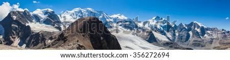 Stunning view of the Bernina massive including Piz Palu, Piz Bellavista, Piz Bernina, Piz Morterasch and Morteratsch glacier from Mountain hut Diavolezza in Engadin area of Switzerland. - stock photo
