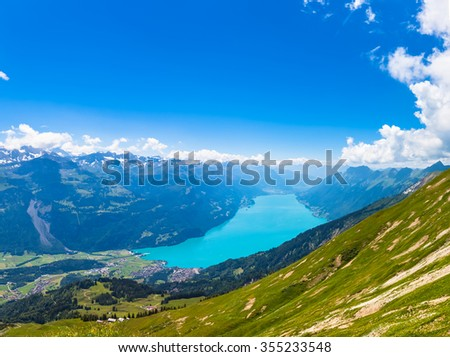 Stunning view of the Brienz lake and the alps from the mountains on hiking trail on Bernese Oberland near the famous tourism region of Interlaken, Jungfrau region, Switzerland. - stock photo