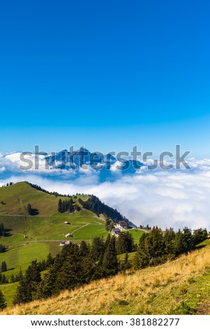 Stunning view of the Pilatus above the clouds from top of Rigi mountain, Lucerne, Switzerland. Vertical composition.