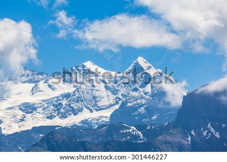 Stunning view of the Schreckhorn and Finsteraarhorn of the swiss Alps on Bernese Oberland in Switzerland. View on the hiking path towards the Brienzer Rothorn.