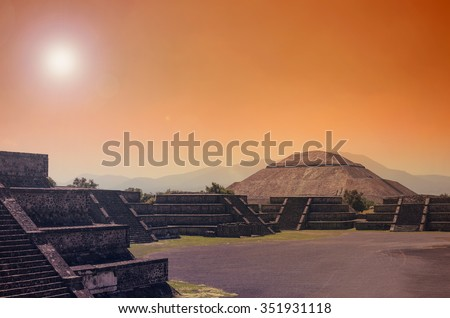 Stunning view to Teotihuacan pyramids in orange sunset light