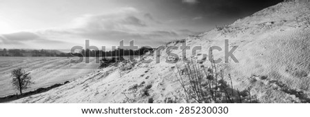 Stunning Winter panorama landscape snow covered countryside in black and white - stock photo