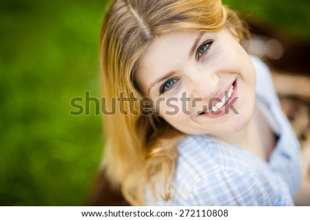 Stunning woman looks back at the camera with a smile on her face.