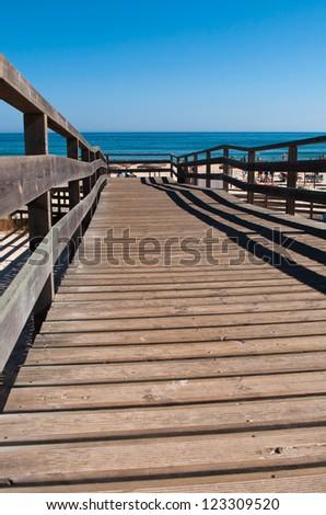 stunning wooden walkway on a sandy beach in Manta Rota (Algarve), Portugal - stock photo