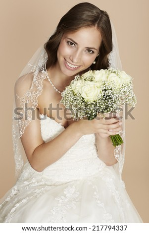 Stunning young bride holding bouquet, portrait