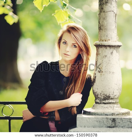 Stunning young woman portrait outside