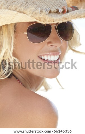Stunningly beautiful and sexy young blond woman in straw cowboy hat and sunglasses - stock photo