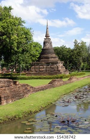 Stupa and moat in old Sukhotai, Thailand - stock photo