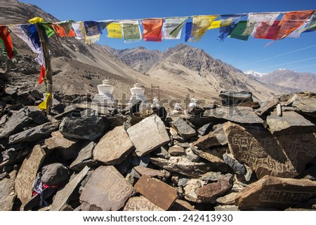 Stupa and player flags near Diskit monastery in Ladakh, Jammu & Kashmir, India - September 2014 - stock photo