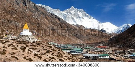 Stupa and prayer flags and Dingboche village with mount Lhotse, way to Everest base camp, Khumbu valley, Solukhumbu, Sagarmatha national park, Nepalese himalayas - stock photo