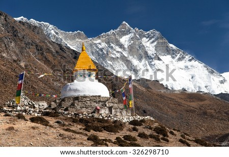 Stupa and prayer flags near Dingboche village with mount Lhotse, way to Everest base camp, Khumbu valley, Solukhumbu, Sagarmatha national park, Nepalese himalayas - stock photo