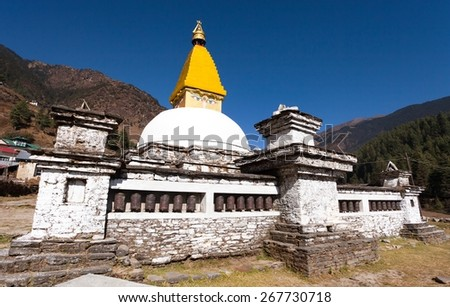 Stupa and prayer wheels in Junbesi village, way to Everest base camp, Nepal - stock photo