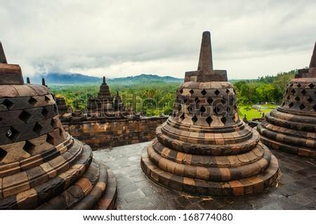 Stupa in Borobudur, ancient buddhist temple near Yogyakarta, Java, Indonesia - stock photo