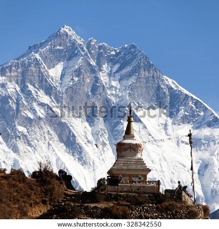 Stupa near Namche Bazar and Mount Lhotse south rock face - way to Everest base camp - Nepal - stock photo