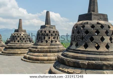 Stupa's at the Borobudur temple in Yogyakarta, Indonesia - stock photo