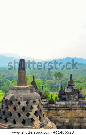 Stupas of Borobudur Temple with mountains in the background, Yogyakarta, Java, Indonesia. Photo taken on 25th May 2014