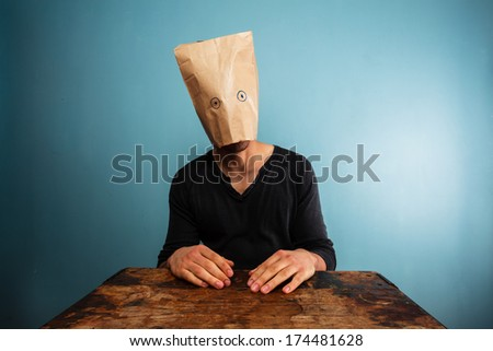 Stupid man with bag over his head - stock photo