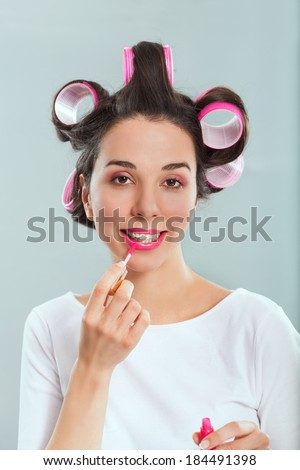 Sturdio portrait of a young stereothypical housewife with make-up - stock photo