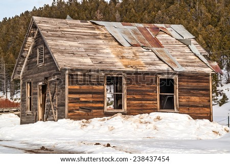 Sturdy building in a Montana ghost town on a beautiful winter day. - stock photo