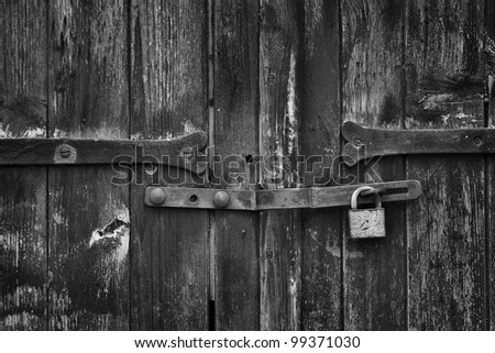 sturdy door closed with a padlock hasp