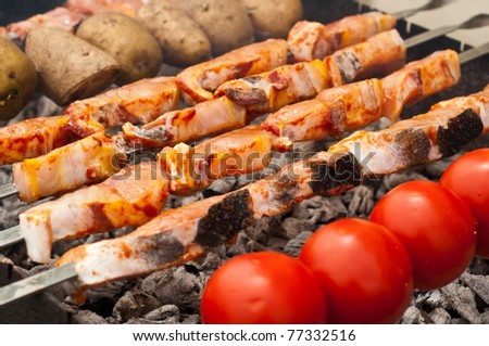 Sturgeon fillets on a skewer grilled - stock photo