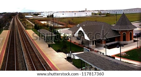 STURTEVANT, WISCONSIN - NOVEMBER 3, 2012: New Amtrak railroad station, Sturtevant WI, double tracks, sees 14 trains daily between Milwaukee to Chicago. Modern design replaces the old station, Nov 3 2012. - stock photo