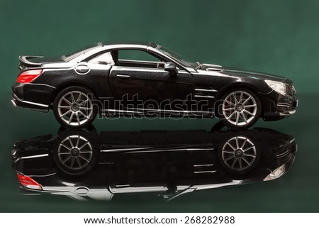 Stuttgart, Germany - APR 04- Mercedes SL 65 AMG on green background, Saturday 04 April 2015 - stock photo