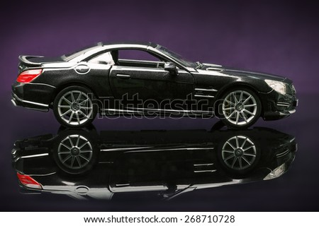 Stuttgart, Germany - APR 04- Mercedes SL 65 AMG on purple background, Saturday 04 April 2015 - stock photo